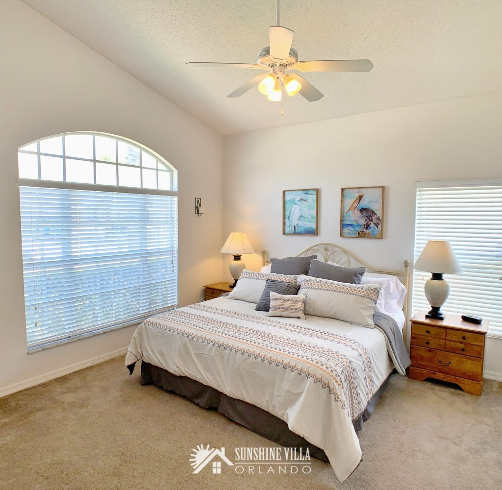 A second master bedroom with a king sized bed and ensuite private bathroom at Sunshine Villa at Glenbrook Resort, a short-term vacation rental home in Orlando near Walt Disney World