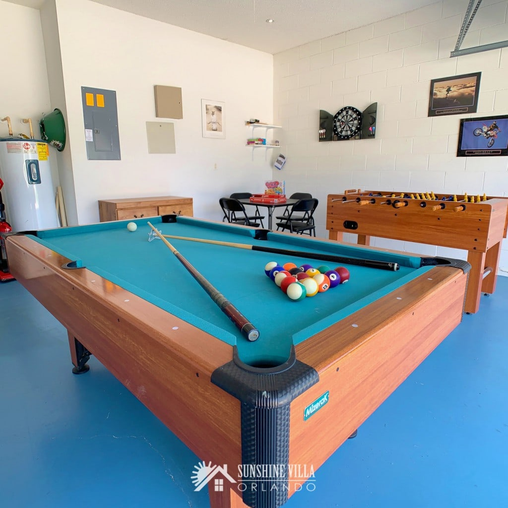 Pool table, card table and foos ball / football table in the Game Room at Sunshine Villa at Glenbrook Resort, a short-term vacation rental home in Orlando near Walt Disney World