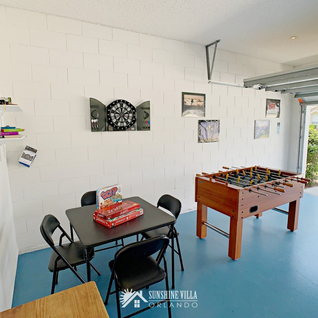 Card table and Foos ball / football table in the Game Room at Sunshine Villa at Glenbrook Resort, a short-term vacation rental home in Orlando near Walt Disney World