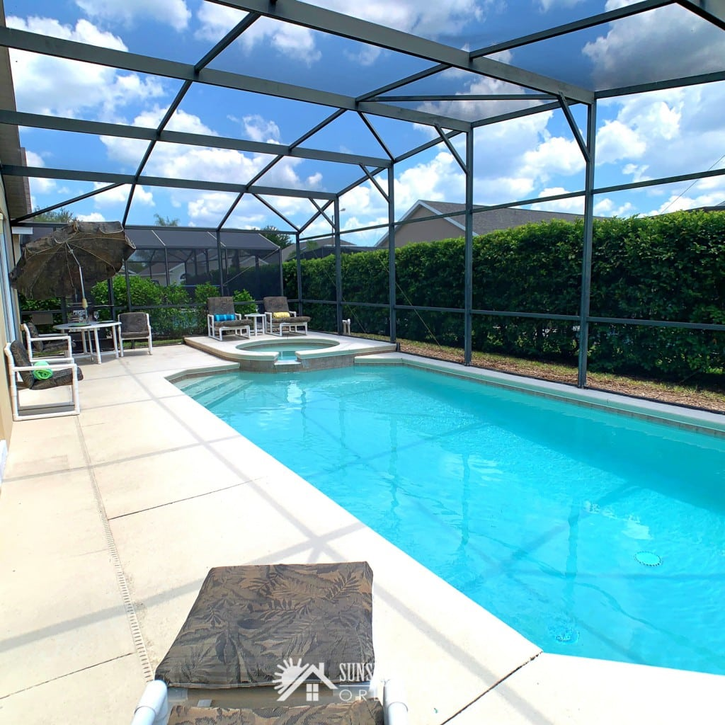 Outdoor Pool with Spa in a screened enclosure at Sunshine Villa at Glenbrook Resort, a short-term vacation rental home in Orlando near Walt Disney World