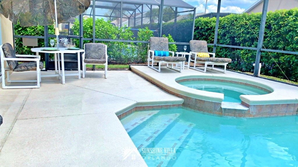 Spa and Pool, Outdoor Umbrella Table and Lounge Chairs on a sunny day in Orlando