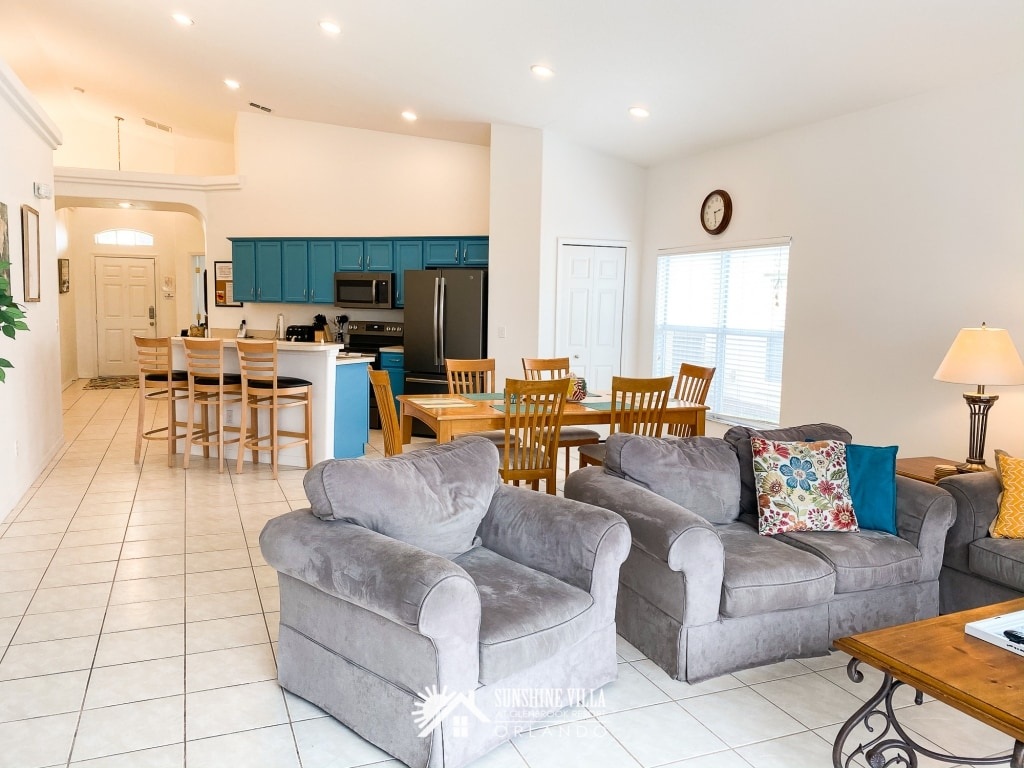 Great room with kitchen, dining area and living room at Sunshine Villa at Glenbrook Resort